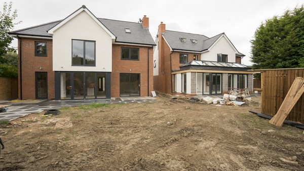Alternative view showing both houses on this small housing develoment plot. Both houses have been fitted with aluminium windows and doors throughout, the house to the right features an orangery with aluminium roof lanterns and dual bifolding doors.