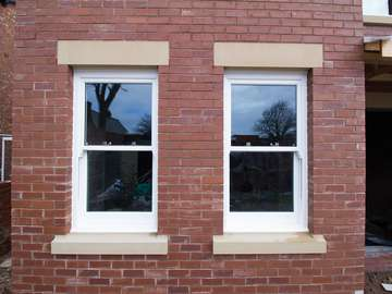Perfectly aligned UPVC sash window installation in Formby, Liverpool.