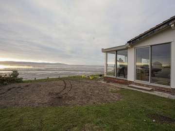 Seaview from the property featuring 3 sets of Dutemann aluminium sliding doors.