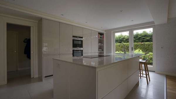 Internal view of the customer kitchen opened up with a set of Rationel french doors.