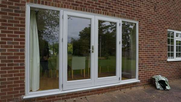 Close up of Rationel alu-clad french doors with side lights.