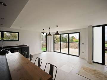 Open plan living space making the most of the view and living areas with bifold doors.