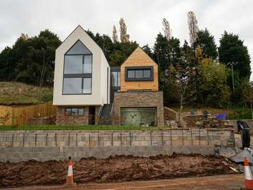 New build property featuring double height aluminium windows in Kelsall, Cheshire.