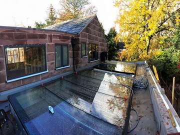 Installation complete on two all glass large flat roof lights.
