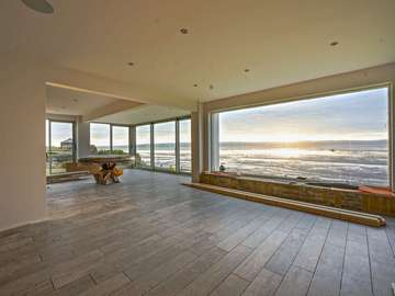 Installation of seagrass green aluminium windows and doors including the Dutemann Glide-S sliding doors throughout this seaside propertry re-development.