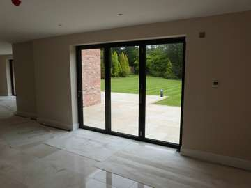 Internal view of our Centor C1 Bi folding doors , 7016 grey. triple glazed . Installtion Poynton cheshire.