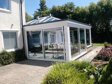 Mr & Mrs W. Caldy wirral : Design and construct orangery. Large dual sliding Allstyle Patio doors double glazed with self cleaning units Orangery with aluminium slidding doors wirral Hoylake near west kirby CH48