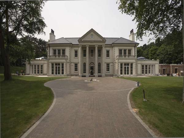 Front on shot of the Palladion Mansion in Formby showing the stunning arched windows.