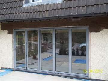 Mrs L. : CALDY WIRRAL : Installation of steel work and removal of brickwork to form opening. S1000 Bi Fold doors. Marine Finish Poyester coated finish Ral 7031 Example of aluminium triple glazed bi-fold doors. Aluminium bi-fold doors near Macclesfield SK11. Alumnus doors with 44mm triple glazing near Alderly Edge SK9. Aluminium Bi-fold doors near Wirral CH48 CH60. Alumnus Bi-fold doors triple glazed Liverpool Formby L37 near South Port PR8 Bi-fold doors near Crosby L23