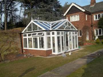 Mr & Mrs R. Willaston . South Wirral _ Design and biuld ; White PvcU Conservatory glazed with Celsius one units to the roof. Planitherm plus to all windows. The biuld included underfloor heating, tiling and all biulding work.