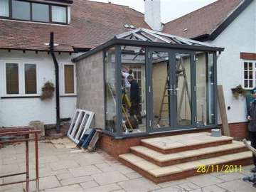 Mr & Mrs D. Bebington Wirral : Design and Build Allstyle Aluminium Conservatory. French doors double glazed - Roof Celsius One self clean Example of aluminium triple glazed bi-fold doors. Aluminium bi-fold doors near Macclesfield SK11. Alumnus doors with 44mm triple glazing near Alderly Edge SK9. Aluminium Bi-fold doors near Wirral CH48 CH60. Alumnus Bi-fold doors triple glazed Liverpool Formby L37 near South Port PR8 Bi-fold doors near Crosby L23