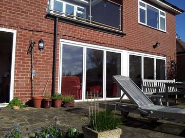 NANTWICH CHESHIRE ; Installation of FSD Aluminium Bi Fold Doors. Triple Glazed - U Value 1.. Std Ral Aluminium folding sliding doors Cheshire near Manchester