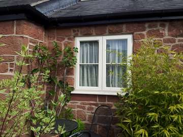 WILLASTON SOUTH WIRRAL: Installation of Evolution Storm Windows. Whitewood cottage style. Double glazed U value 1.6 pvcu sliding sash window frames cheshire