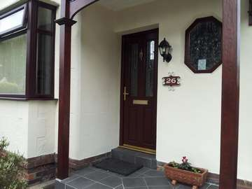 Miss F. Bebington. Installation of a Apeer 70 Triple Glazed Composite door Rosewood with Gold triple Glazed beveled Leaded units