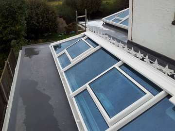 Mr & Mrs K. Irby Wirral : Installtion of 2 no Aluminium - PvcU Clad skylights. Double glazed with Celsius one glass- U value 1. Electric roof vent with rain censors