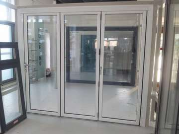 New Hybrid Bi Fold door; fabricated with an alumnium Outer frame , PvcU Door leaves creating the reliablity of Alumnium slim lines at the cost of PVCU