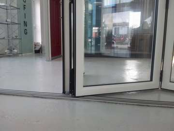 Close up photo of the new PvcU Hybrid Bi Fold door running track to give a fush floor finish. 135mm sight lines
