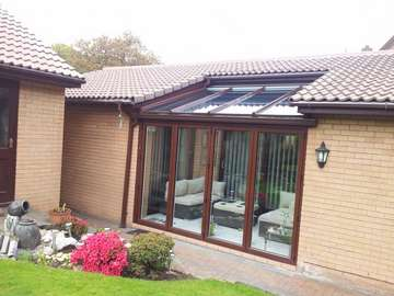 "Overton , Frodsham, cheshire. Design and biuld Conservatory. Constructed from ""Allstyle"" Alumnium Bi folding doors, double glazed. ATS Wood foil roof glazed with celcius one self cleaning glass U value 1."