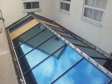 Commercial installation of an ATS aluminium thermally broken 28mm double glazed roofing system with a bespoke solarfilm to allow employee welfare (reduction of computer screen glare)