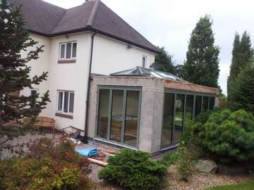 MR B, Macclesfield : New build orangery extension with Centor C1 Bi-fold doors with 44mm triple glazing painted in with a marine finish (RAL 9017)and an ATS lantern roof light with 44mm triple glazing painted with a marine finish (RAL 9017). Building contractor Johnathen Simons.
