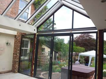 Mr & Mrs E, West Kirby, Wirral : Internal view of Centor C1 double glazed Bi-fold doors with marine finish. With a combination Allstyle gable ended double glazed point. Aluminium spared ATS roof system with double glazed celsius glass.