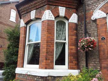 "Mr B. : Sale Manchester - Insatlltion of Bygone melody Whitewood foiled Vertical sliding windows. Double Glazed with ""A"" Rated certification . Note Run through Horns . Large Bottom rial and bespoke arched head to match existing timber frames"