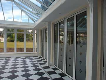 North Wales Mold - Installation of S1000 White Aluminium Bi fold doors double glazed in a K2 Portal Conservatory - Glass Celsius one clear North Wales PvcU Bi fold doors with aluminium Windows North Wales