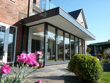 Caldy Wirral : Design and build - 4000 series Bi fold doors - sarnafil roof cover. Aluminium Fascias Aluminium Centor C1 Bi fold doors - Aluminium Slimfold Bi fold doors - Aluminium Triple glazed bi fold doors - Aluminium Bi fold doors with walk on flat doors Wirral - Aluminium Bi fold with balcony over had doors Heswall CH60 - Aluminium Bi fold doors Cheshire - Aluminium Bi fold doors with adjoining aluminium side window Chester CH1 - Aluminium Bi fold doors Liverpool - Aluminium Bi fold doors Formby L37 Aluminium Bi fold doors Crosby L23 - Our Aluminium Bi fold range is polyester powder coated. They can come with either 28 mm argon filed double glazing or 44mm argon filed triple glazing. Our range of Aluminium Bi-fold doors are Centor C1, Schuco, allstyle, Upvc, and wood Bifolds. Our Aluminium Bifolds can be found on the Wirral in areas such a Caldy CH48, Aluminium Bifold doors can also be found in West Kirby CH48. Due to an explosion in property in Liverpool there are ma