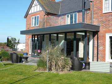 Caldy wirral : design and build: CLR Balustrade system 15mm heat-soak Toughened glazing . - 44m argon filled triple glazed bi fold doors - Manchester - Aluminium Bi fold doors Didsbury M20 - Aluminium Bi fold doors Prestbury SK10 - Aluminium Halebarns WA15 - Aluminium Bi fold doors Nantwich CW3 - Aluminium Bi fold doors Macclesfield SK11 - Aluminium Bi fold doors North west - Centor C1 Bi fold doors North west - Centor C1 Bi fold doors Cheshire - Centor C1 Bi fold doors Liverpool Centor C1 Bi fold doors Formby L37 - Centor C1 Bi fold doors Crosby L23 Our Aluminium Bi fold range is polyester powder coated. They can come with either 28 mm argon filed double glazing or 44mm argon filed triple glazing. Our range of Aluminium Bi-fold doors are Centor C1, Schuco, allstyle, Upvc, and wood Bifolds. Our Aluminium Bifolds can be found on the Wirral in areas such a Caldy CH48, Aluminium Bifold doors can also be found in West Kirby CH48. Due to an explosion in property in Liverpool there a