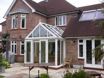 Professor H. Formby Lancashire : Alteration : Installation of an Ultraframe White PvcU Capped Roof Triple glazed with Pilkington Activ K U value 1. Windows and doors 2500 Deceuninck White PvcU triple glazed with 36mm units U value .85. to form walk in Conservatory