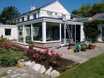 Mr & Mrs W. Caldy Wirral . Design and biuld . Orangery - K2 Roof system. Aluminium External cappings Glazed with Celsius one. Large Marine finish S Therm Sliding doors. Double glazed. Roof covering Sarnafil . Fascia Bespoke Timber to match house