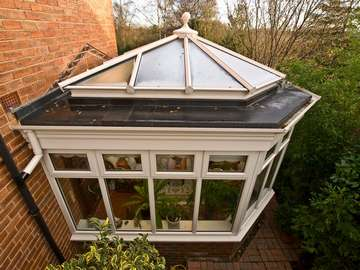 Miss A. Lower Heswall, Wirral : Design and build orangery. quanta Aluminium lantern light glazed with Celsius clear double glazed units. Firestone roof covering. Feature PvcU Fascia. 2800 white PvcU frames double glazed with Hytherm sealed units.