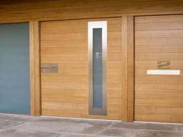 Design Consulting : Altringham . Manchester : Installation of an Urban Oak Entrance door and frame . Natural stain finish