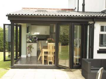 HESWALL WIRRAL : Installation of Smart 4000 Aluminium Bi Fold doors - Double glazed - Matt finish Ral 9017 Example of aluminium triple glazed bi-fold doors. Aluminium bi-fold doors near Macclesfield SK11. Alumnus doors with 44mm triple glazing near Alderly Edge SK9. Aluminium Bi-fold doors near Wirral CH48 CH60. Alumnus Bi-fold doors triple glazed Liverpool Formby L37 near South Port PR8 Bi-fold doors near Crosby L23