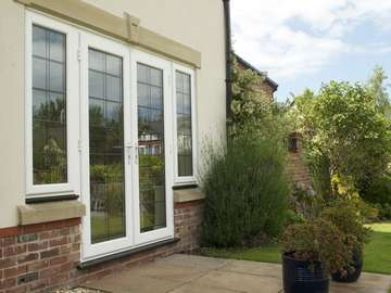 Mr H. - Formby: Installation of triple glazed PvcU French doors. Secure by design locking system. Black ash external window sills.