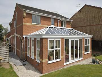 Warrington : Mr & Mr N : Design and build Orangery . roof K2 with Celsius one glass. Roof covering Sarnafil . 2800 Deceuninck window and doors triple glazed