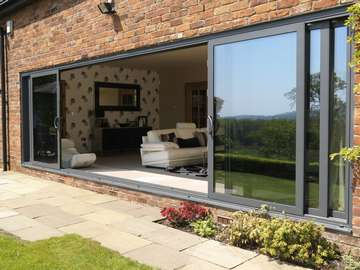 Mold , North Wales : Installation of Allstyle Multi Sliding Aluminium large Doors. Double glazed with Planitherm Low E Units