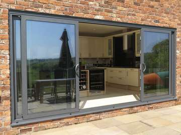 Mold , North Wales : Installation of a second set Allstyle Multi Sliding Aluminium large Doors. Double glazed with Planitherm Low E Units to the kitchen area