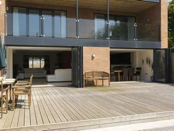Eccles Manchester : Self Build Installation of Alstyle Polyester Powder Coated slimline Bi Folding doors. Double Glazed with Planitherm Plus Sealed units with Integral Blinds. also showing 15mm heat-soaked Balastrading