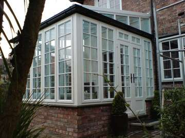 Mr & Mrs F. : Hoylake Wirral : Design and Build conservatory. Evolution Storm Whitewood PvcU doors and window. White wood Aluminium reinforced roof