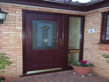 Dr A. Bromborough , Wirral. Rosewood Rockdoor combination with designed bevel glass double glazed
