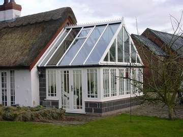 Design and Biuld project : Corwen Nr Wrexham : Evolution storm windows in white whitewood , Astragal bar to Architects design . Roof K2 double glazed with Celsius one