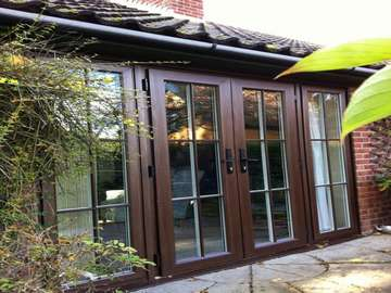 Hollywell, North Wales : Installation of our 2500 Rosewood PvcU Chamfered framed french doors complete with 16mm Astragal bar to match the original doors.