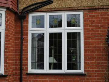 Mr D. : Hoylake Wirral : Installation of a D2800 White PvcU window glazed with 40mm triple glazed Units U value .7. Design leadlights to match existing windows