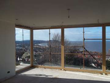 Mr & Mrs D. Colwyn Bay, North Wales : Internal view of an Installation of Internorm Alu Clad windows. Internal spruce with clear stain.