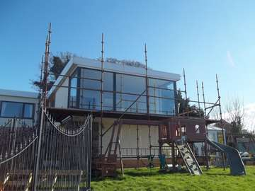Mr & Mrs D. Colwyn Bay, North Wales : Installation of Internorm Alu Clad windows Glazed with 48mm triple glazed units fabricated from 3 no 6mm toughened panals U value .5
