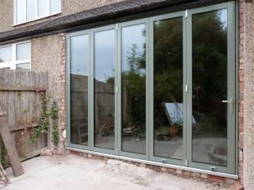 MOLD , NORTH WALES : Centor C1 Bi Folding doors triple glazed with 44mm seled units . Example of aluminium triple glazed bi-fold doors. Aluminium bi-fold doors near Macclesfield SK11. Alumnus doors with 44mm triple glazing near Alderly Edge SK9. Aluminium Bi-fold doors near Wirral CH48 CH60. Alumnus Bi-fold doors triple glazed Liverpool Formby L37 near South Port PR8 Bi-fold doors near Crosby L23