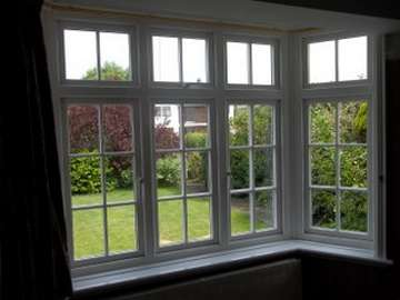 "NORTHWICH CHESHIRE - Internal view of an Installtion of Evolution ""STORM 2 "" white wood PvcU Bay window , complete with Astragal bar glass design and dummy sash look to give the glass the same size panes."