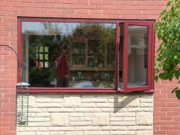 NESTON. CHSHIRE . Installtion of G. barnsdales Timber window fabricated in Red Gradis Hardwood, stained Mahogany to match existing Hardwood frames. All Timber windows and doors Come pre painted or stained