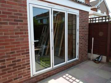 "Mr V. : Crosby Liverpool - Installtion to a self biuld extention . white Hybrid Bi folding doors. slim line profile 135 vision lines. 28mm ""A"" rated double glazed units manufactured with Planitherm + Low E Glass. Argon Gas filled caverty."